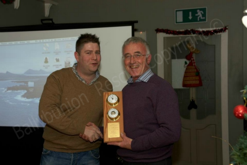 Gearoid O Connor Presenting Mike Flahive with a plaque for 25 years of outstanding service as a founding memebr sill serving