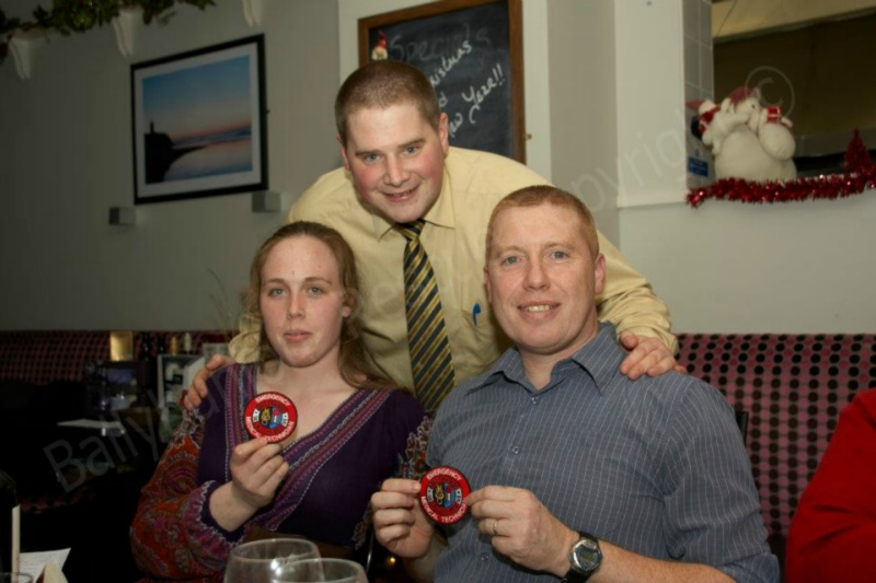 Omar Fitze, EMT Tutor presenting Grace Flahive and Emmet Lynch with BSCR EMT patches after passing their EMT exams